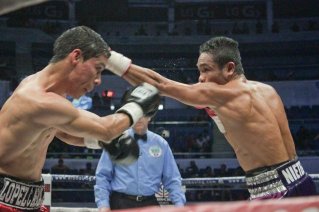 Nietes' effective jab; PINOY PRIDE 30 D-Day was held at the SMART Araneta Coliseum last March 28, 2015. Photo by Jude Bautista