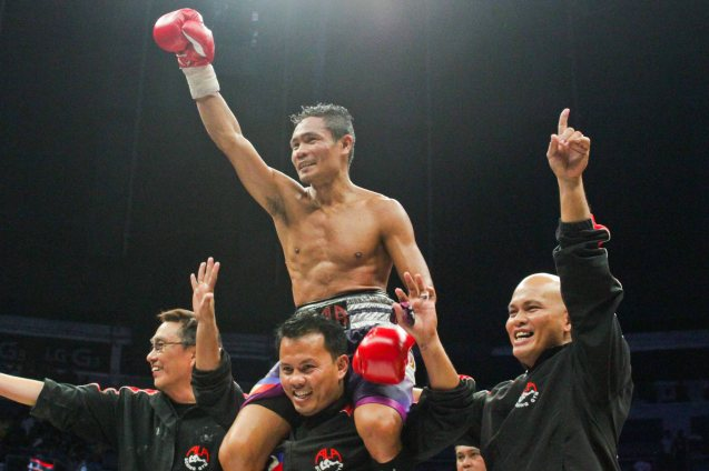 Donnie Nietes raises his hand in victory after he successfully defends his WBO World Jr Flyweight Belt for the 7th time. PINOY PRIDE 30 D-Day was held at the SMART Araneta Coliseum last March 28, 2015. Photo by Jude Bautista