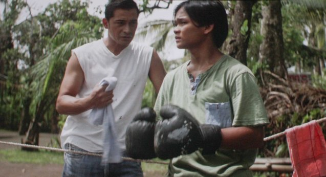 Sardo (Cesar Montano) set up Manny (Buboy Villar) for impromptu match in his yard. After KID KULAFU's successful run in the Philippines it will also be released in the U.S. and Canada. Click on this link for cities and release dates: http://abscbnpr.com/untold-story-of-manny-pacquiao-revealed-in-kid-kulafu/