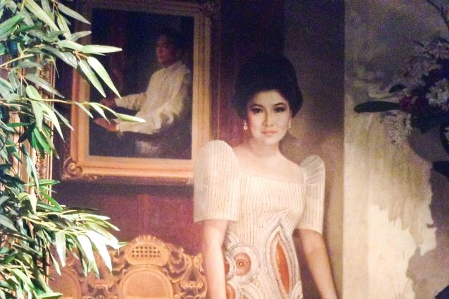 One of the portraits of Imelda Marcos posing in front of Pres. Ferdinand Marcos' portrait that can be seen in the Marikina Shoe Museum. ASIA ON SCREEN 2015 film fest will run at the Shang Cineplex, Shangri-La Plaza Mall from May 8-12, 2015. Photo from Official MARIQUINA fb page https://www.facebook.com/mariquinathemovie/timeline