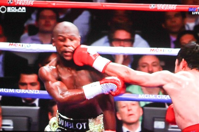 Pacquiao lands hard straight left flush on Mayweather.