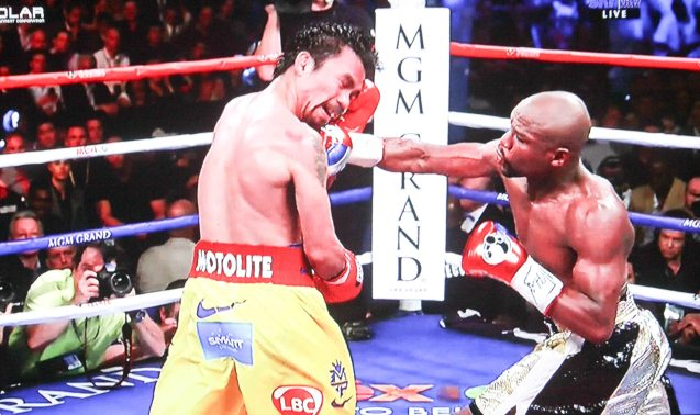 Mayweather lands hard right counter.