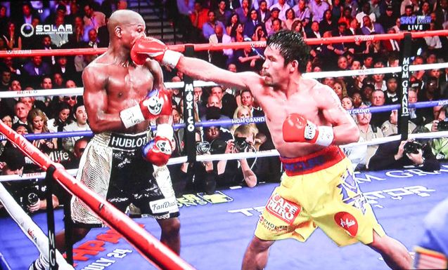 Pacquiao lands hard straight right flush on Mayweather.