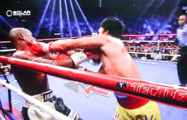 Pacquiao lands left hook