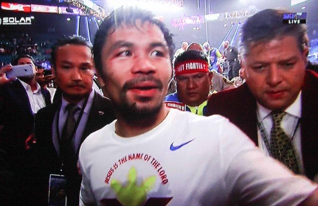 Manny praises Jesus Christ through his official Nike T Shirt.