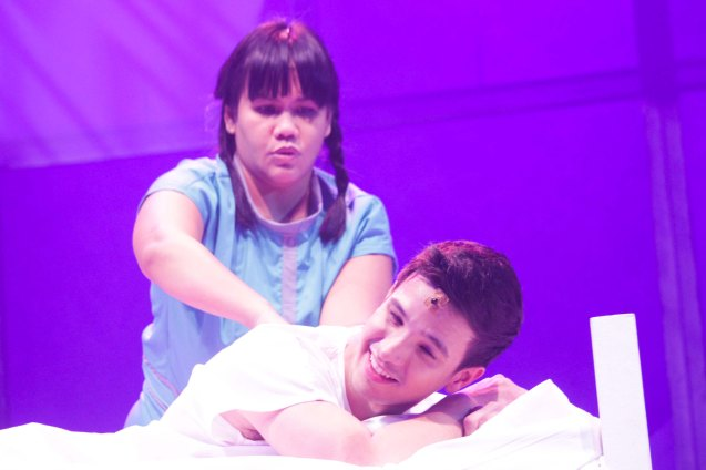 Bituin Escalante (Mely) gives a massage to Markki Stroem (Leading Man). Dalanghita productions' KUNG PAANO AKO NAGING LEADING LADY will run in PETA from May 9 to June 7, 2015. Photo By Jude Bautista