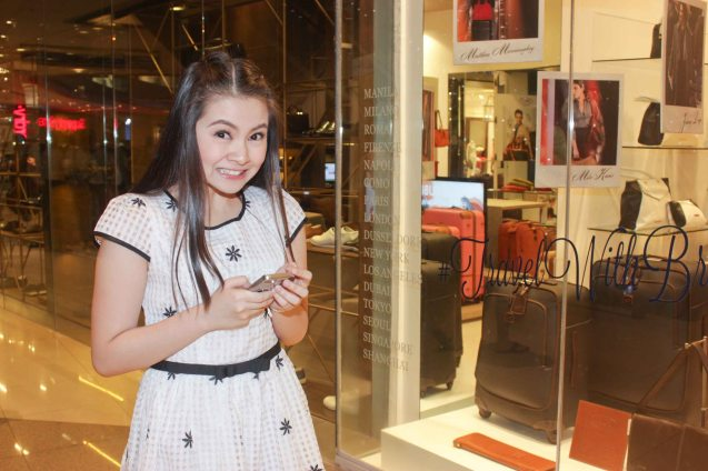 Barbie Forteza tweets in front of BRIC'S Milano Italian Travel Bags in East Atrium of Shang Mall. ASIA ON SCREEN 2015 film fest will run at the Shang Cineplex, Shangri-La Plaza Mall from May 8-12, 2015. Photo by Jude Bautista