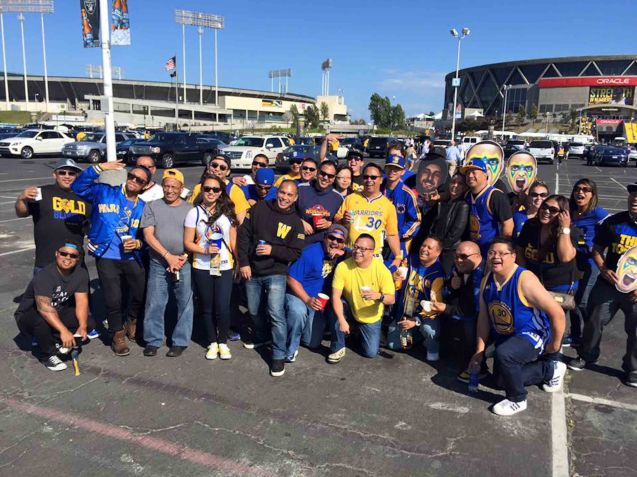 JP Nebres a long time Warriors fan shoots his fellow Filipino Americans tailgating outside the Oracle Arena.