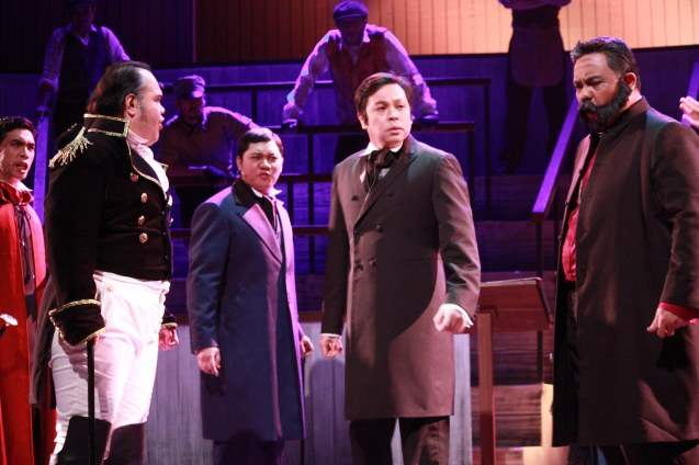 "They gang up on The Dawn front man Jett Pangan (center) as Dr. Jekyll from right: Red Nuestro (Bishop of Basingstoke), Jamie Inocian (Sir Archibald Proops) , Oliver Usison (General Lord Glossop /Minister) and Reuben Uy (Lord Savage). Repertory Phil.'s ""Jekyll & Hyde"" ran from March 16-April 15, 2012. Photo by Jude Bautista"
