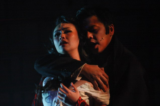 "The Dawn front man Jett Pangan as the lead role with Kalila Aguilos as the seductive Lucy Harris. Repertory Phil.'s ""Jekyll & Hyde"" ran from March 16-April 15, 2012. Photo by Jude Bautista"