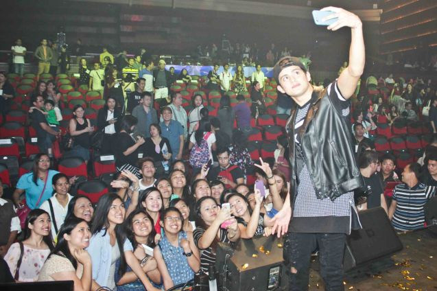 James Reid shoots selfie w a fan's android. The PhilPOP 2015 Finals Night was held at the MERALCO THEATER last July 25, 2015. Photo by Jude Bautista