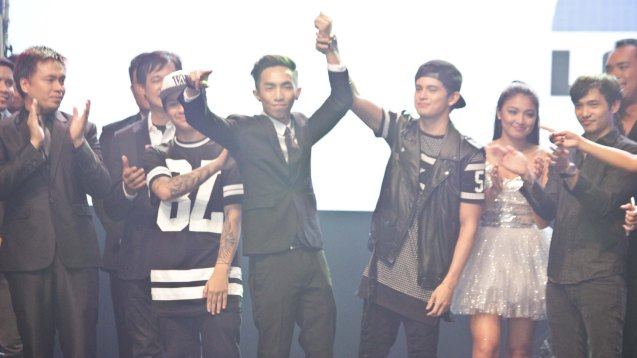 James Reid raises songwriter MC Magno's (MUSIKAW) hand. The PhilPOP 2015 Finals Night was held at the MERALCO THEATER last July 25, 2015. Photo by Jude Bautista