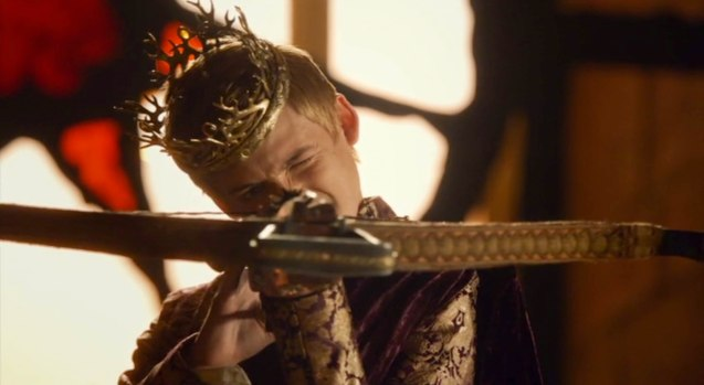 King Joffrey (Jack Gleeson) randomly shoots his subjects with a crossbow.