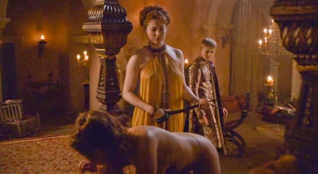 King Joffrey (Jack Gleeson) after being gifted with two whores by Uncle Tyrion satisfies his sadistic urges.