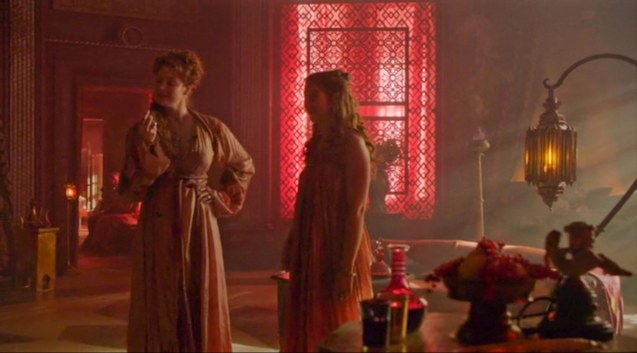from left: Ros (Esmé Bianco) gives Shae (Sebil Kekilli) a tour of Lord Baelish' brothel.