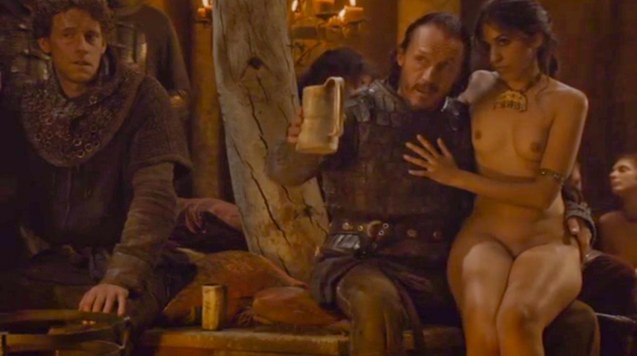 from right: Exotic treat (Sahara Knight) with Sir Bronn (Jerome Flynn)