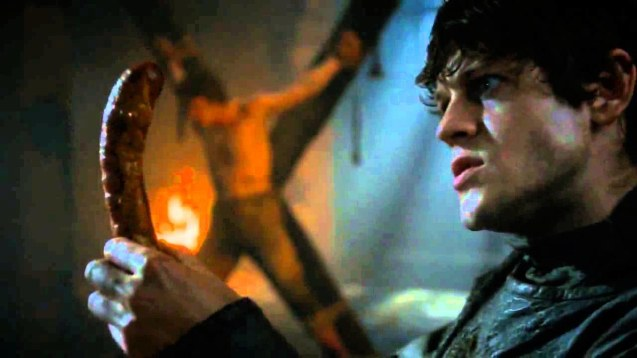 Ramsay Bolton (Iwan Rheon) has sausage for dinner after castrating Theon.