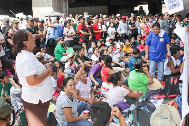 Protesters sit on the intersection to stop traffic Aug 30, 2015 at EDSA corner Shaw Boulevard. Photo by Jude Bautista