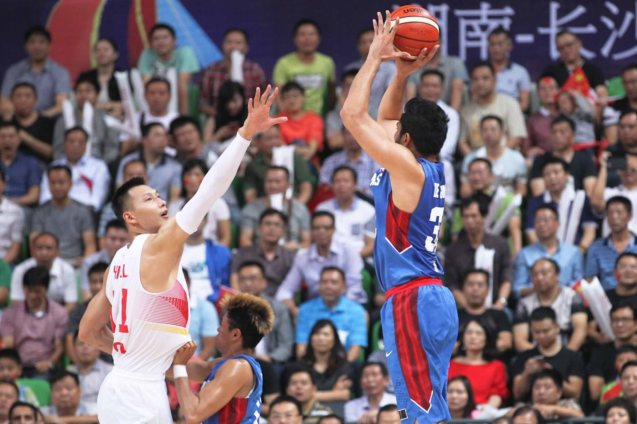 Ranidel De Ocampo jumper contested by Yi Jian Lian; FIBA Asia Finals game PHI v CHINA October 3, 2015 at the Changsha Social Work College, Chang Sha, China. Photo from FIBA.com.