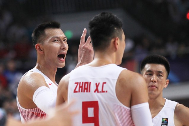 Yi Jian Lian fires up teammates; FIBA Asia Finals game PHI v CHINA October 3, 2015 at the Changsha Social Work College, Chang Sha, China. Photo from FIBA.com.