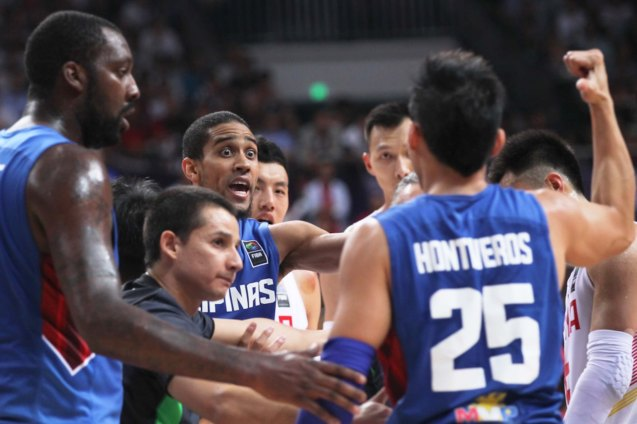Dondon Hontiveros and Gabe Norwood contest one of many bad and confusing calls; FIBA Asia Finals game PHI v CHINA October 3, 2015 at the Changsha Social Work College, Chang Sha, China. Photo from FIBA.com.