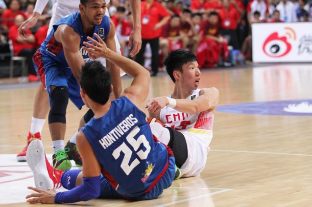 "Dondon Hontiveros and 7'3"" center Zhuo Qi get tied up; FIBA Asia Finals game PHI v CHINA October 3, 2015 at the Changsha Social Work College, Chang Sha, China. Photo from FIBA.com."