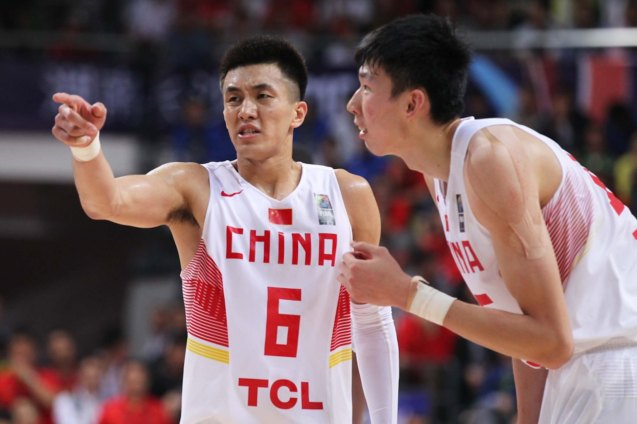 Ailun Guo and center Zhou Qi still manage to complain to the refs; FIBA Asia Finals game PHI v CHINA October 3, 2015 at the Changsha Social Work College, Chang Sha, China. Photo from FIBA.com.