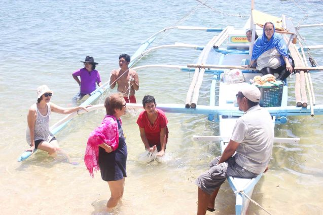 Chatting in crystal clear waters in barangay Canomay, Claveria, Burias Island, May 18, 2015. Photo by Jude Bautista