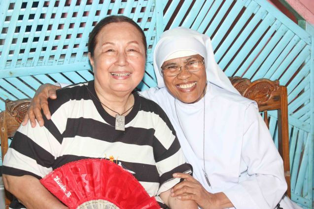 from left: Erlinda Bautista and Sister Peñafrancia Misa of the Holy Face of Jesus; Claveria, Burias-May 18, 2015. Photo by Jude Bautista