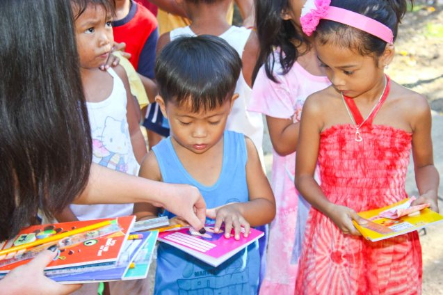 Kids are thankful for their school supplies and candy; Claveria, Burias-May 18, 2015. Photo by Jude Bautista