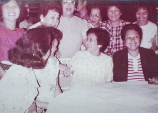 Pres. Corazon Aquino in yellow-checkered blouse, Linda Bautista (red stripe) was a YWCA volunteer in Malacañang post EDSA Revolution. That's my aunt Lily B. Yang greeting Pres. Cory.