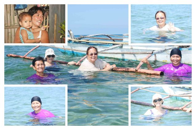 Ladies enjoy the cool waters in Malapinggan beach, Burias Island-May 19, 2015. Photo by Jude Bautista