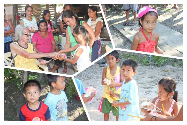 Kids receive school supplies from Tito PD; Claveria, Burias Island-May 18, 2015. Photo by Jude Bautista