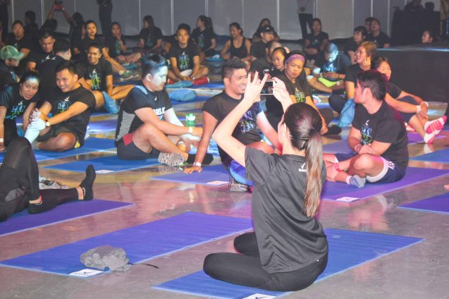 Celeb Nicole Anderson shoots her co participants with her i-phone. RXN FIT FEST was held at the SMX Convention Center last Nov 14, 2015. Photo by Jude Bautista