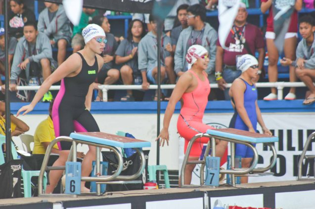 from left ADMU-Romina Gavino, UP-Pricilla Aquino and ADMU Dominiq Reyes before the 200m freestyle. Photo was taken October 24, 2015 during 78th UAAP Swimming competitions at the Rizal Memorial Swimming Complex. Photo by Jude Bautista