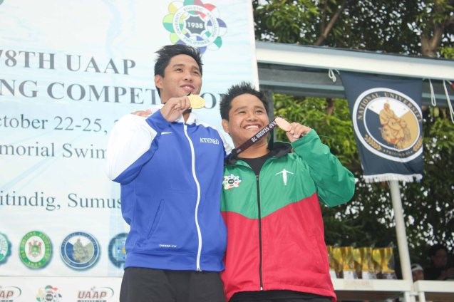 Men's 200m freestyle left gold medalist Jessie Khing Lacuna(ADMU) and right bronze medalist Dexter John Lacuna (UP). Photo was taken October 24, 2015 during 78th UAAP Swimming competitions at the Rizal Memorial Swimming Complex. Photo by Jude Bautista