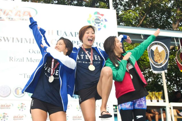 Women's 200m freestyle center- Gold medalist Kim Uy (ADMU), left- Silver Medalist Ariana Herranz (ADMU) and right- bronze medalist Winona Tee Ten (UP)/ Photo was taken October 24, 2015 during 78th UAAP Swimming competitions at the Rizal Memorial Swimming Complex. Photo by Jude Bautista