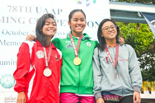 Girls 200m Freestyle center-gold Nicole Meah Pamintuan (DLSU), left-silver Carmenrose Matabuena (UE), right-bronze Zoe Marie Hiario (UP). Photo was taken October 24, 2015 during 78th UAAP Swimming competitions at the Rizal Memorial Swimming Complex. Photo by Jude Bautista