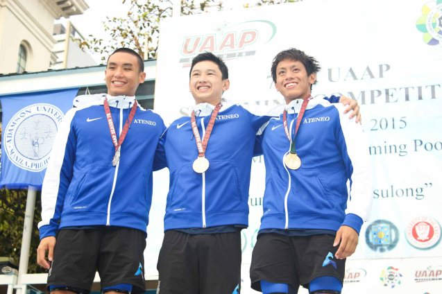 ADMU top3 center- gold Gian Carlo Silva, left-silver Alberto Batungbacal, right-bronze Paolo Gabriel Mutuc at the Men's 100m backstroke. Photo was taken October 24, 2015 during 78th UAAP Swimming competitions at the Rizal Memorial Swimming Complex. Photo by Jude Bautista