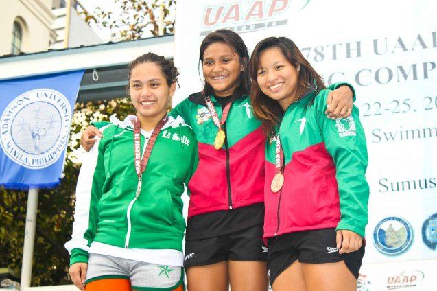 Women's 100m backstroke center-gold Joy Rodgers(UP), left-silver Sabrina Ingrid Ilustre (DLSU), right-bronze Ma. Kristina Beatrice Bartolome (UP). Photo was taken October 24, 2015 during 78th UAAP Swimming competitions at the Rizal Memorial Swimming Complex. Photo by Jude Bautista