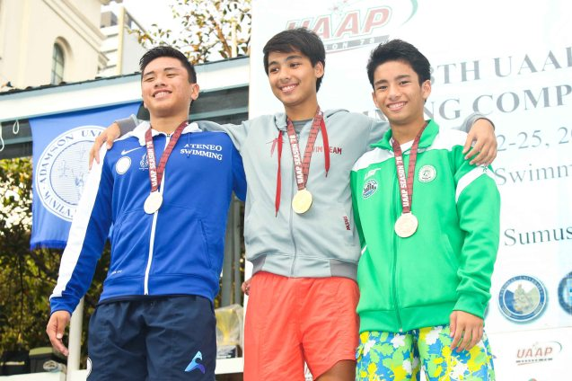Boys 100m Breaststroke center-gold Drew Benett Magbag (UP), left-silver Joshua Taleon (ADMU), right-bronze Yuri Ilustre (DLSU). Photo was taken October 24, 2015 during 78th UAAP Swimming competitions at the Rizal Memorial Swimming Complex. Photo by Jude Bautista