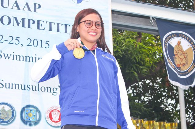 Lady Eagle Hannah Dato shows one of seven gold medals she won. Photo was taken October 24, 2015 during 78th UAAP Swimming competitions at the Rizal Memorial Swimming Complex. Photo by Jude Bautista