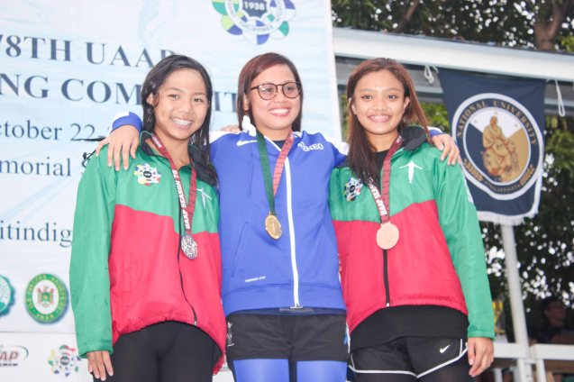 Women's 50m Butterfly center- gold Hannah Dato (ADMU), left-silver Janna Mikayla Taguibao (UP), right-bronze Ma Teresa Dela Rosa (UP). Photo was taken October 24, 2015 during 78th UAAP Swimming competitions at the Rizal Memorial Swimming Complex. Photo by Jude Bautista