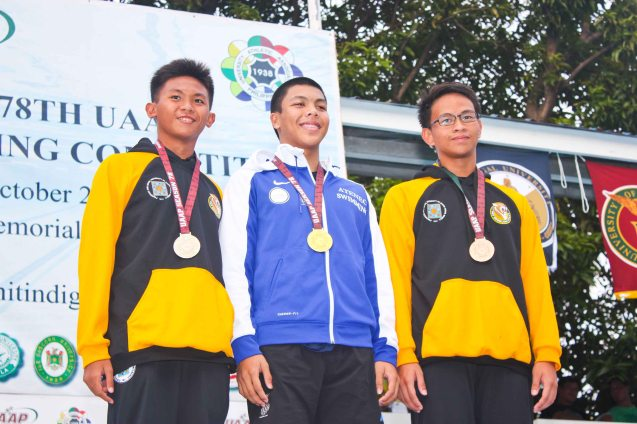 Boy's 50m Butterfly center- gold Rafael Barreto (ADMU), left-silver Gabriel Guerrero (UST), right-bronze Alonzo Magadia (UST). Photo was taken October 24, 2015 during 78th UAAP Swimming competitions at the Rizal Memorial Swimming Complex. Photo by Jude Bautista