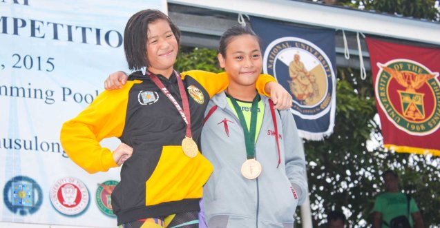 Girl's 50m Butterfly from left -gold Camille Lauren Buico (UST) and bronze Franz Emmanuel Joves (UP). Photo was taken October 24, 2015 during 78th UAAP Swimming competitions at the Rizal Memorial Swimming Complex. Photo by Jude Bautista