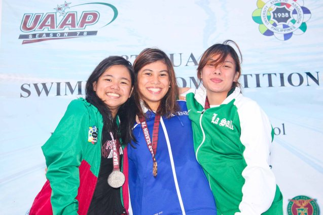 Women's 100m Backstroke center-gold Ariana Herranz (ADMU), left-silver Anna Dominique Bartolome (UP), right-bronze Catherine Bondad (DLSU). Photo was taken October 24, 2015 during 78th UAAP Swimming competitions at the Rizal Memorial Swimming Complex. Photo by Jude Bautista