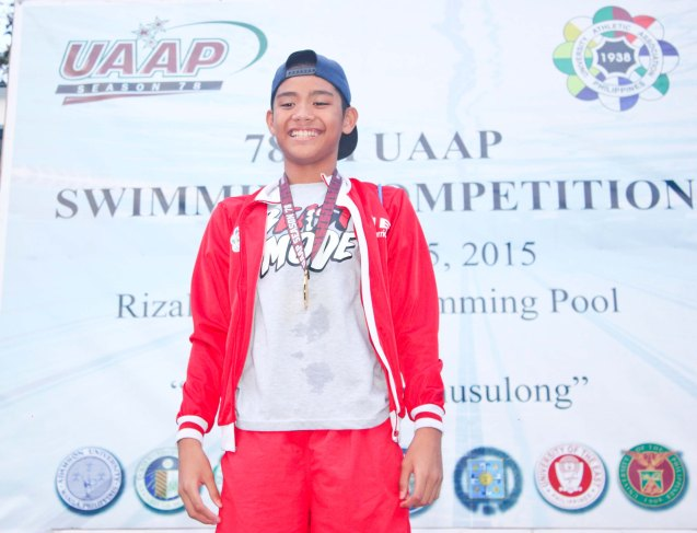 UE earned its first Boy's division gold medal from Jerard Jacinto at the 100m Backstroke. Photo was taken October 24, 2015 during 78th UAAP Swimming competitions at the Rizal Memorial Swimming Complex. Photo by Jude Bautista