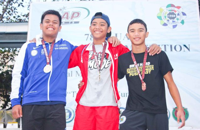 Boy's 100m Backstroke center-gold Jerard Jacinto (UE), left-silver Akiva Jose Cariño (ADMU), right-bronze Sean Terence Zamora (UST). Photo was taken October 24, 2015 during 78th UAAP Swimming competitions at the Rizal Memorial Swimming Complex. Photo by Jude Bautista