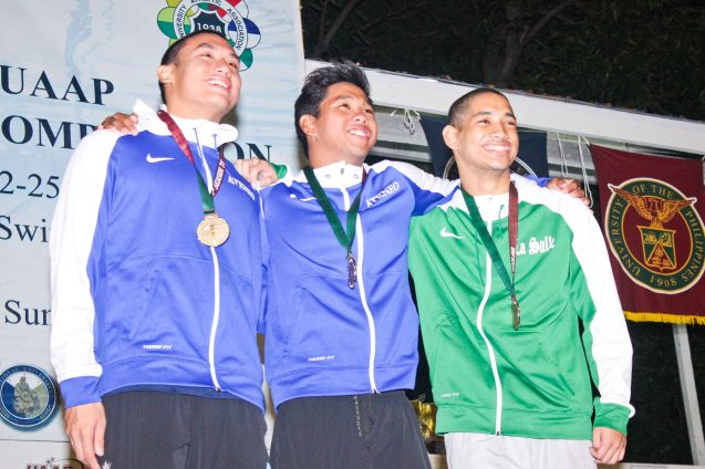 Men's 400m IM center-gold Jessie Khing Lacuna, left-silver Alberto Batungbacal, right-bronze Arian Neil Puyo. Photo was taken October 24, 2015 during 78th UAAP Swimming competitions at the Rizal Memorial Swimming Complex. Photo by Jude Bautista