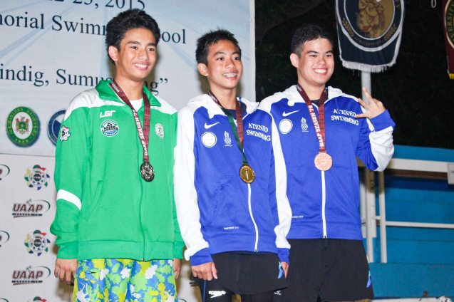 Boys 400m Individual medley gold-center Philip Joaquin Santos (ADMU), left-silver Yuri Ilustre (DLSU) and right-bronze Miguel Antonio Arellano (ADMU). Photo was taken October 24, 2015 during 78th UAAP Swimming competitions at the Rizal Memorial Swimming Complex. Photo by Jude Bautista